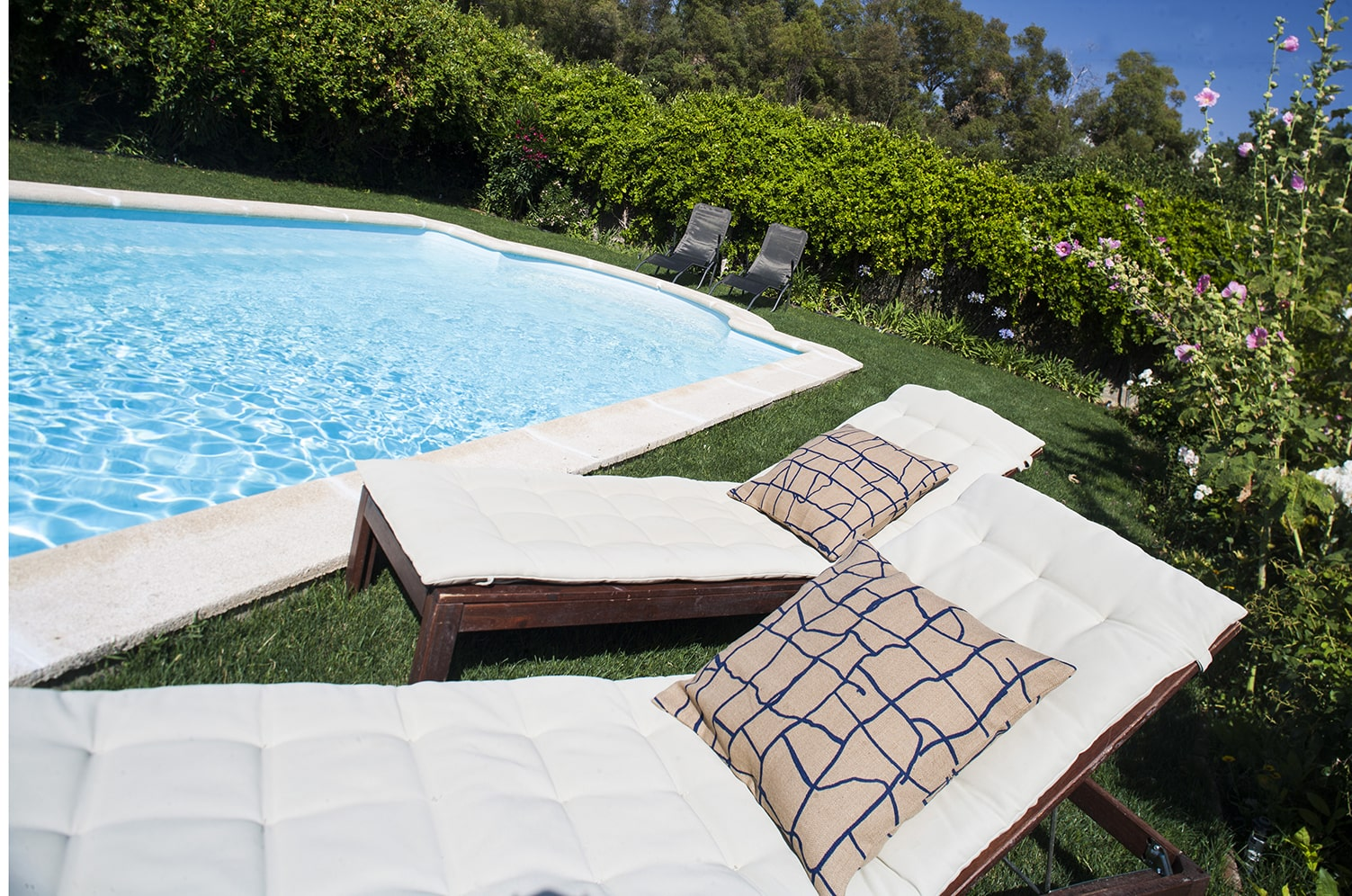 pool side with sunloungers
