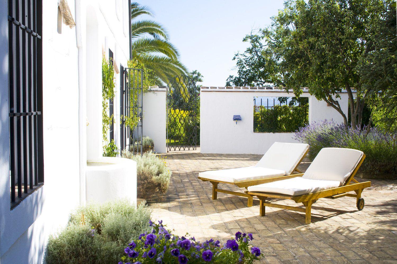 sunbeds in courtyard at villa