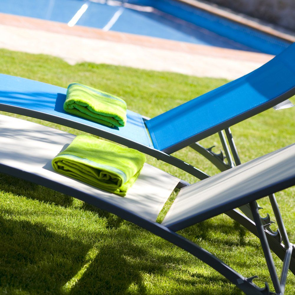 sunbeds by pool